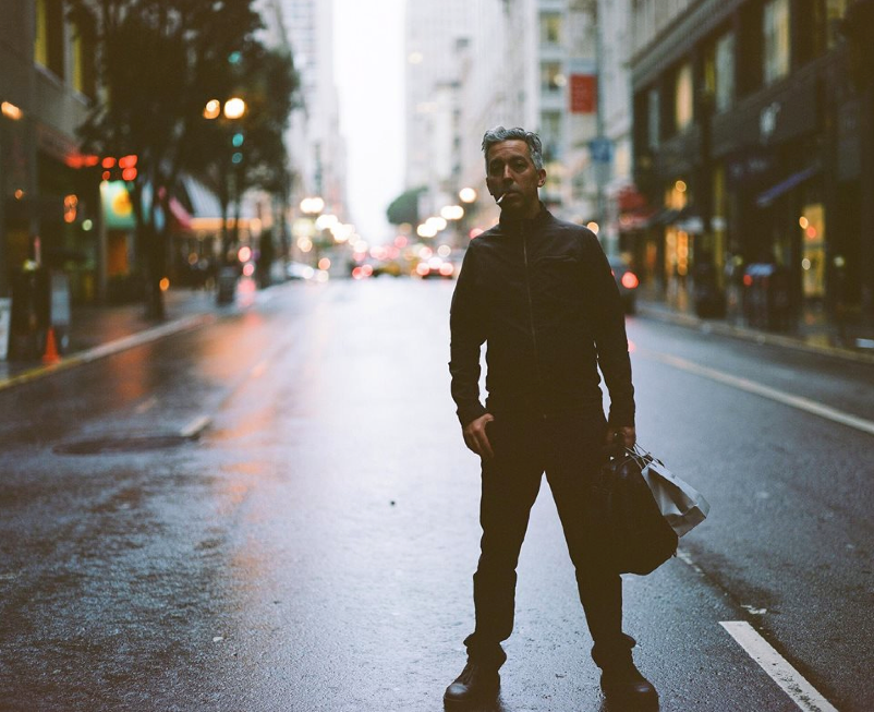 Street Photography -Kyle Hartman with his stunning rainy street portrait captured on Portra 400 with a Pentax 67! He'll be receiving a Fuji GA645zi medium format film camera!