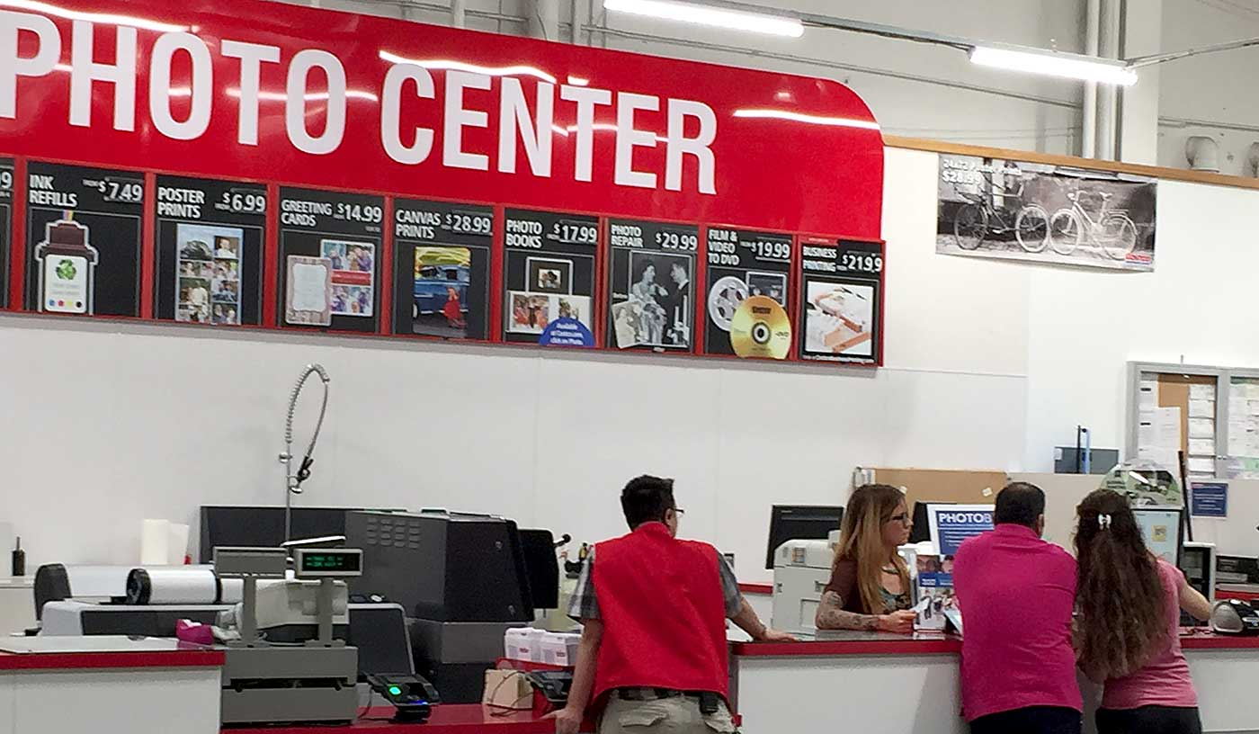 Costco employee helping customers in the Costco Photo Center