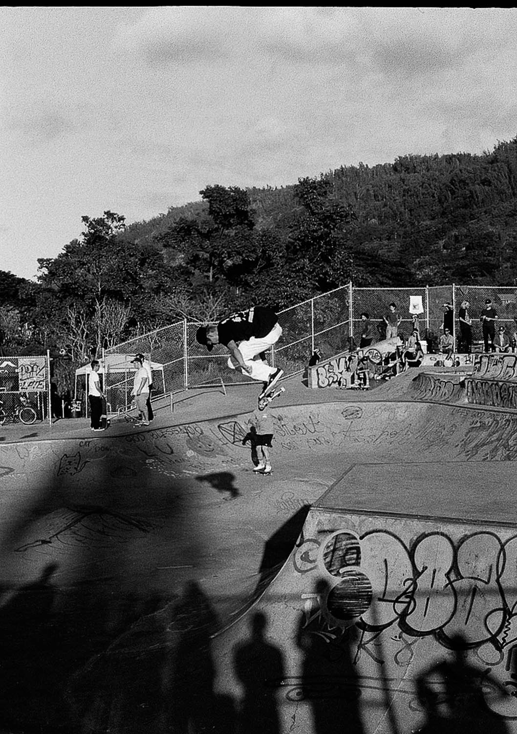 Evan Mock getting some air at the RVCA Skate event in Hawaii. Shot on my Olympus PenFT at box speed.