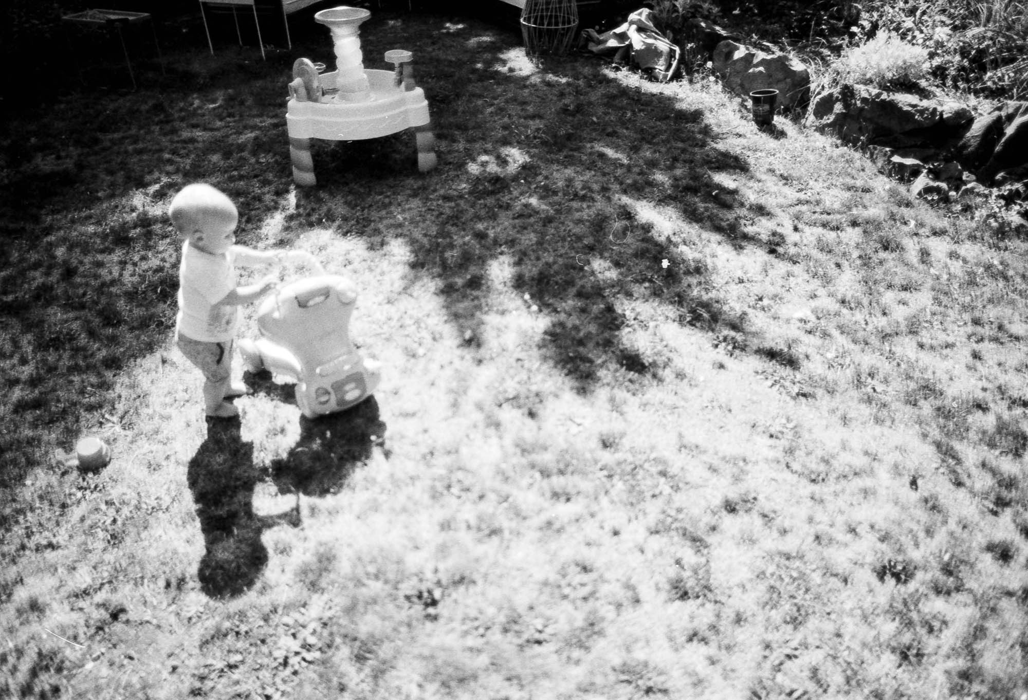Child plays in the backyard. This shows the latitude that this film holds. It was a bright day and you can see both highlight and shadow detail. Canon EOS 3, Canon 24mm f1.4 lens