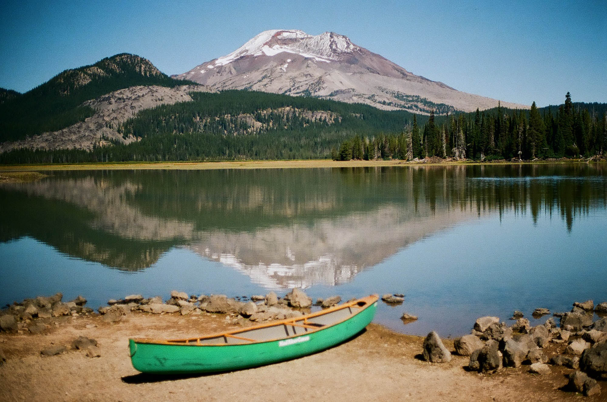 Lomography 400 ~ Canon AE-1 ~ Canon 50mm F1.8 South Sister Mountain in Central Oregon reflects in the calm waters of Sparks Lake. A perfect day for a paddle