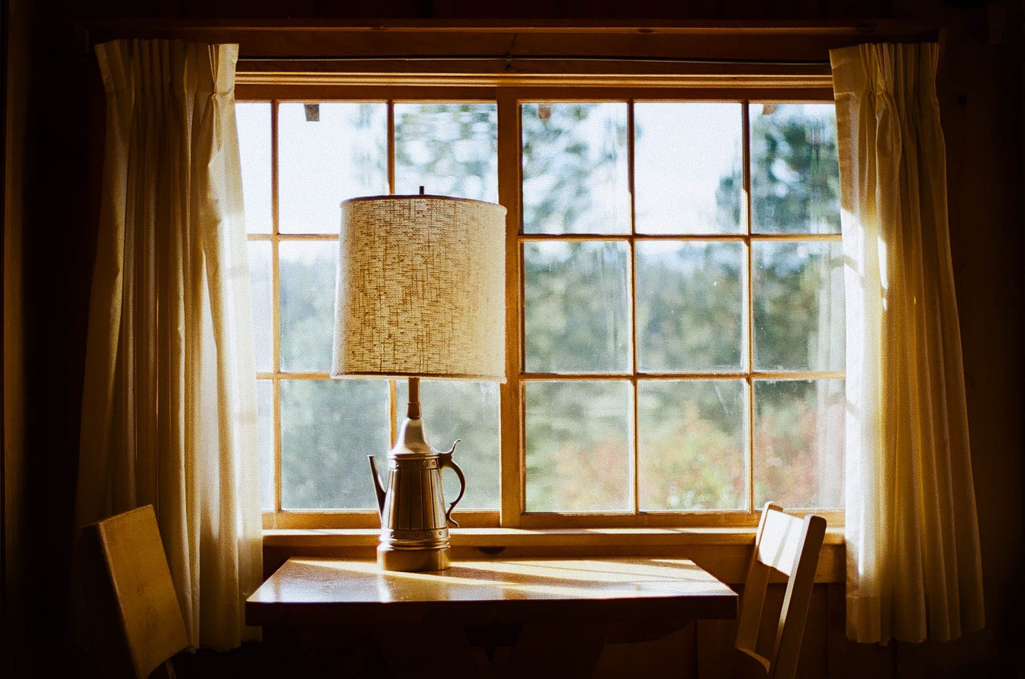 Lomography 400 ~ Canon AE-1 ~ Canon 50mm F1.8 A cosy nook in a 1920's riverside cabin catches beautiful side light