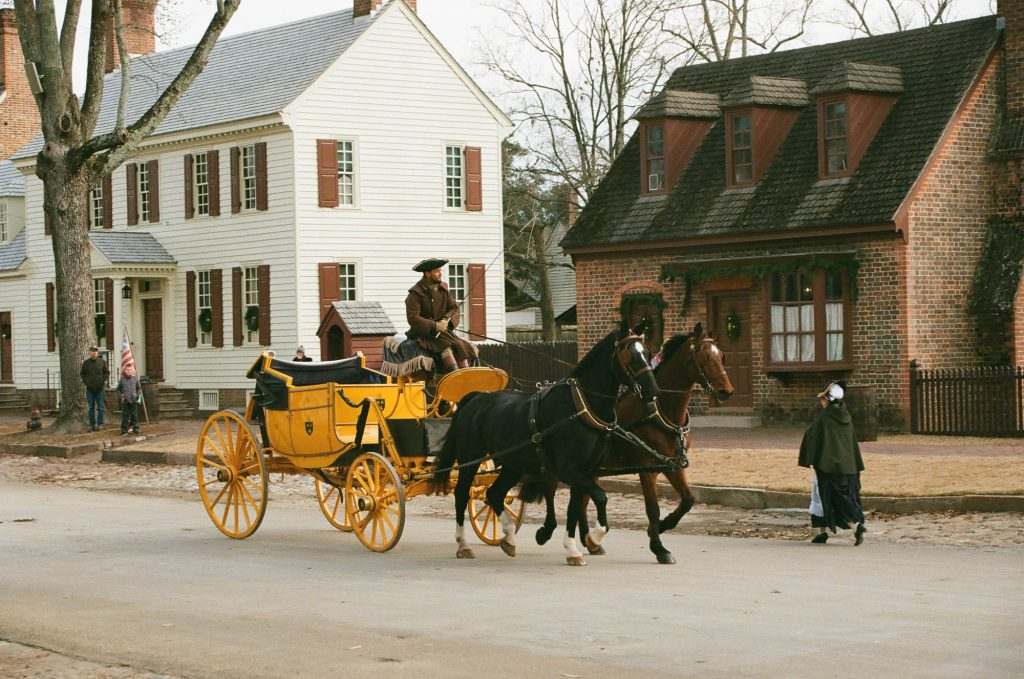 A Horse-Drawn Carriage makes its way down Duke of Gloucester Street in Colonial Williamsburg, Virginia.