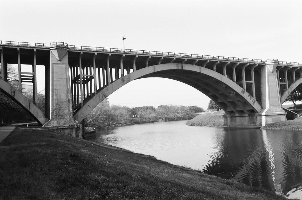 Bridge with green grass in forground