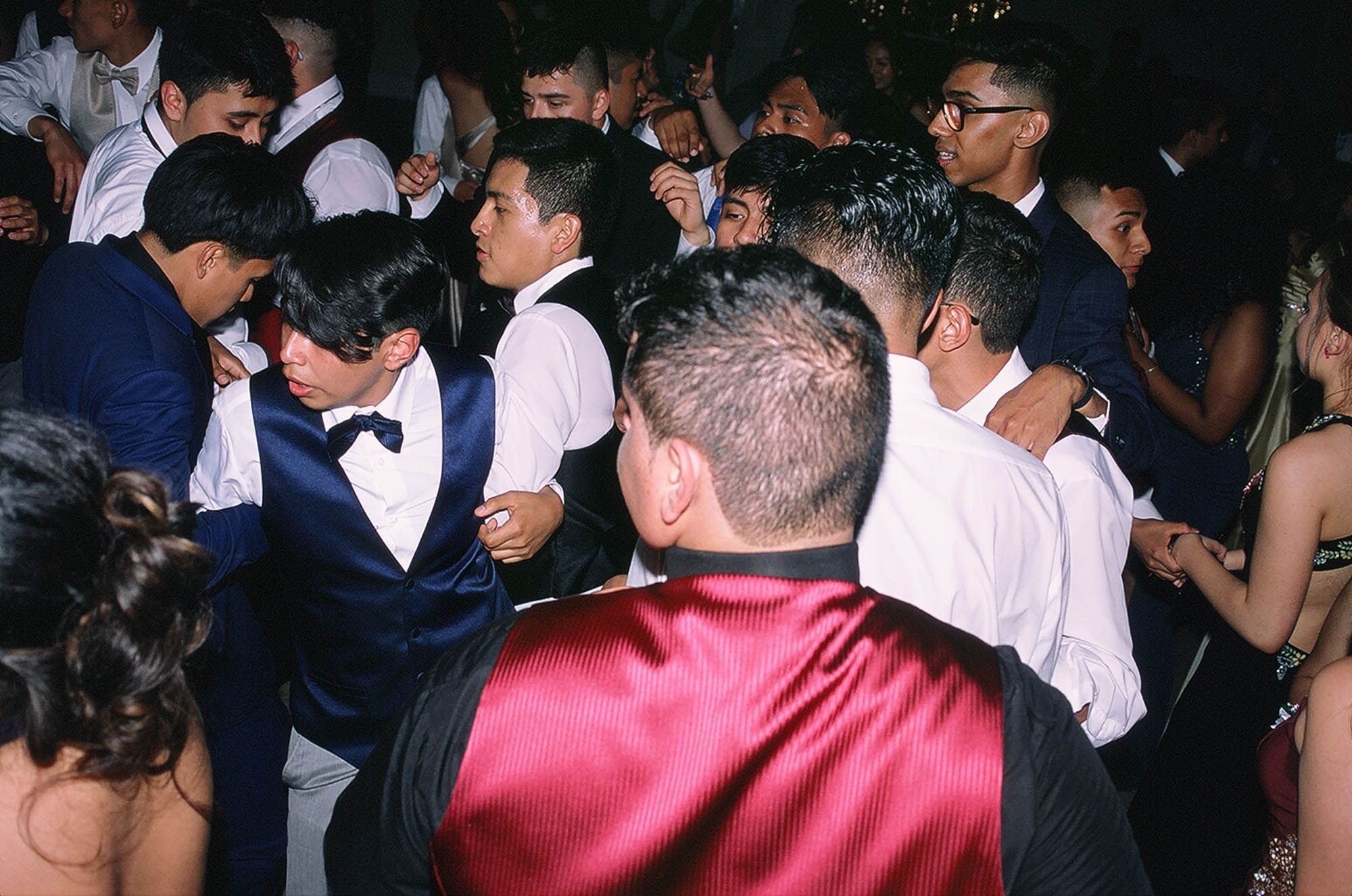 Prom pictures while people dancing. Date: May 31, 2019 Shot on Fujifilm Fujichrome Provia 100F