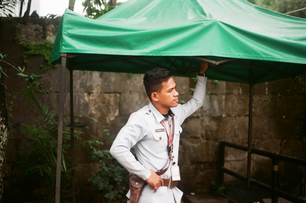 A photo of a guard in Intramuros, Philippines. Shot with an Olympus OM-G.
