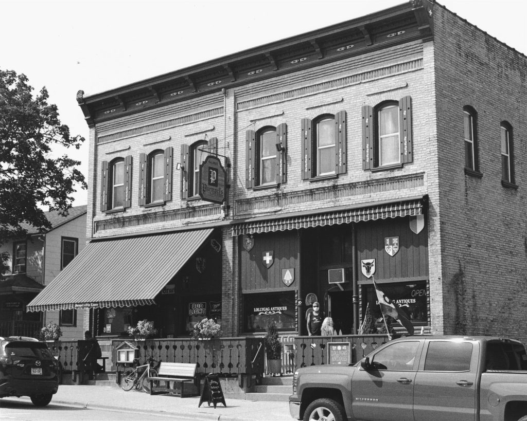 A local tavern that's been in business for over 115 years. Scan of a darkroom print. Shot with a Rollei 35. T-Max 400 processed in D-76.