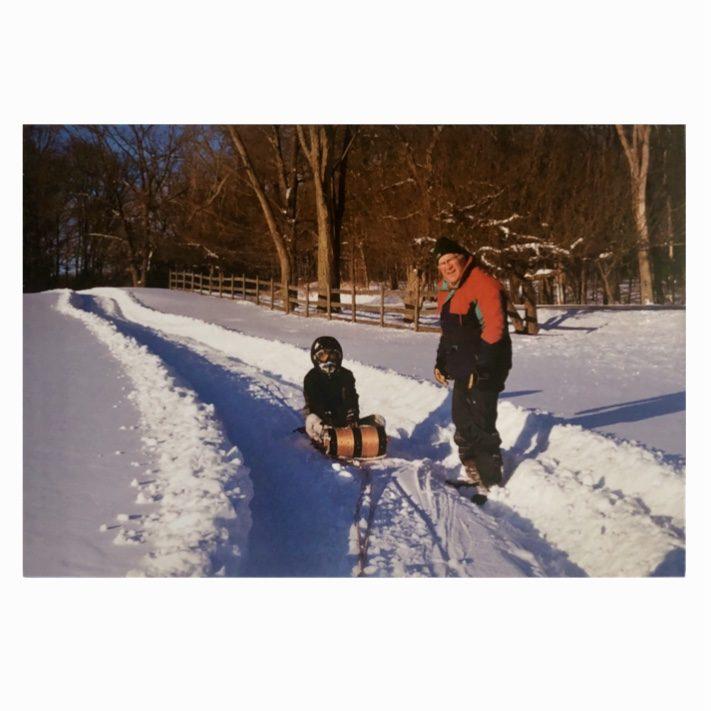 Grandpa and his Grandson sledding