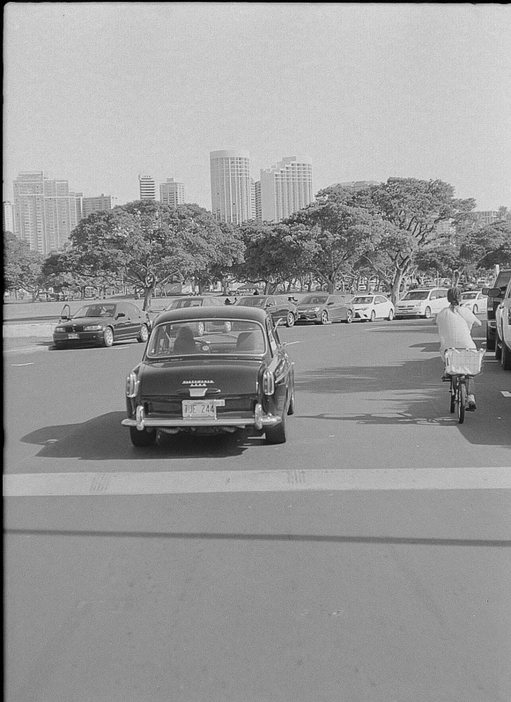 The hardest shot I've ever taken. I had to chase this car down on my skateboard to get this shot. This is Honolulu, Hawaii near the beach walk.